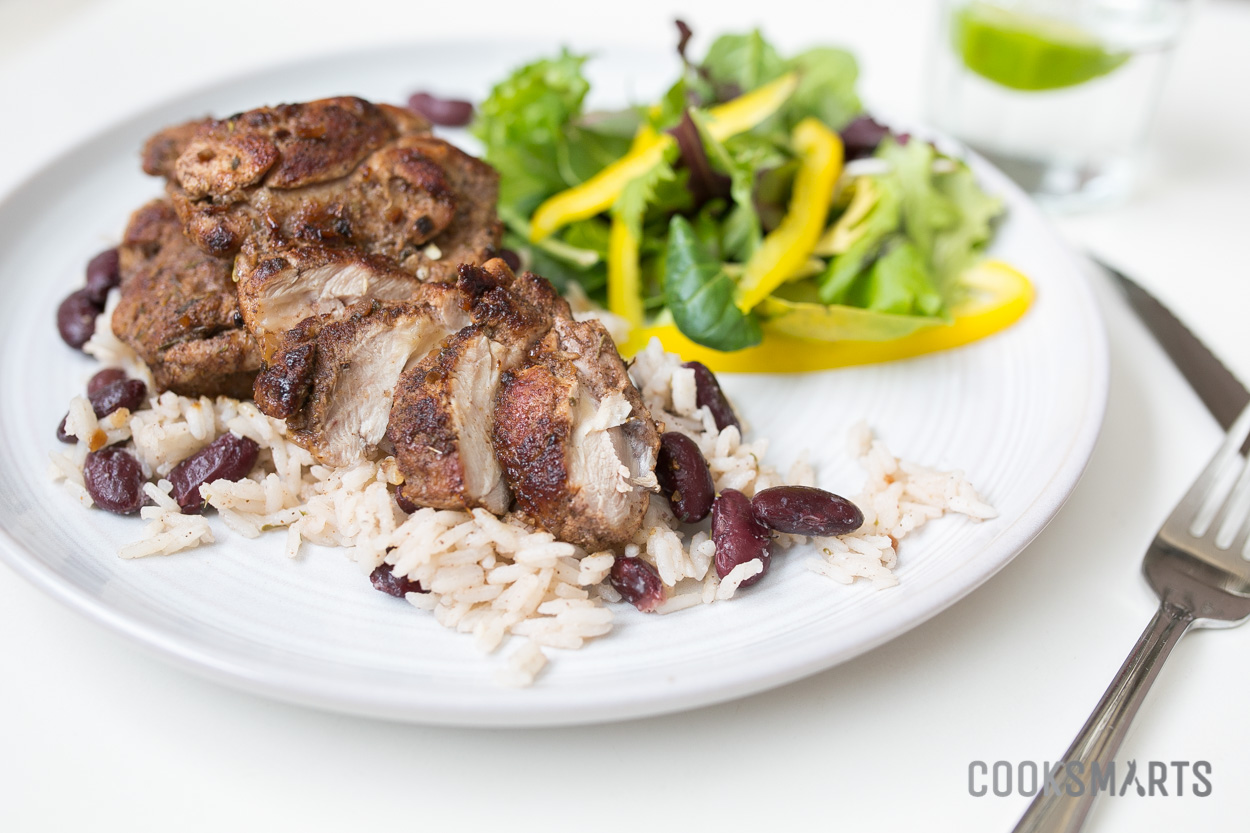 Jerk Chicken Thighs with Coconut Rice and Beans | #mealplan via @CookSmarts